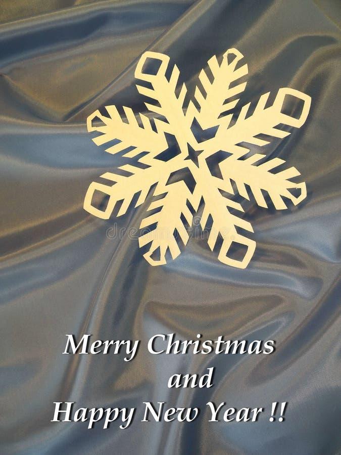 Vrolijke gedaane Kerstmis en Gelukkige Nieuwjaarskaart gebruikend document sneeuwvlok, Litouwen royalty-vrije stock foto's