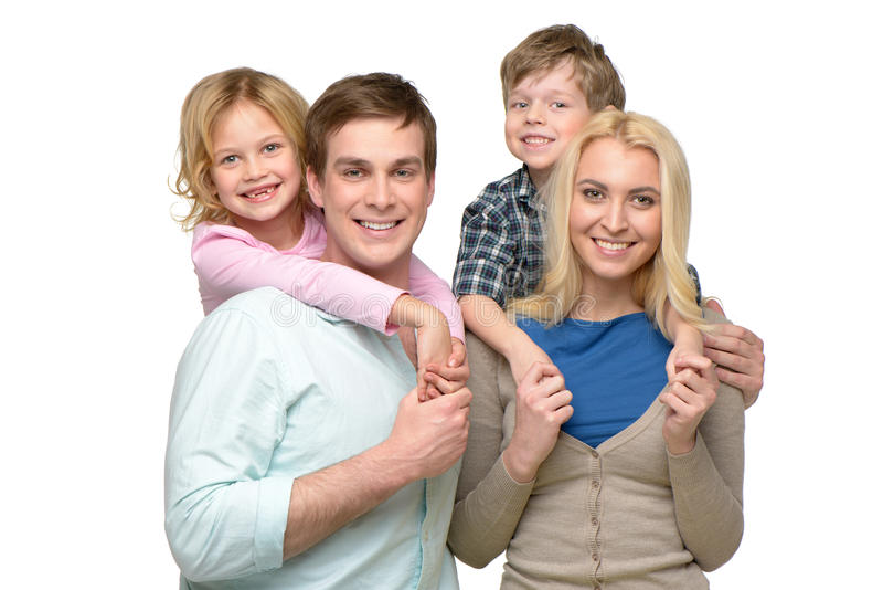 Vrolijke glimlachende familie van vier die camera bekijken royalty-vrije stock fotografie