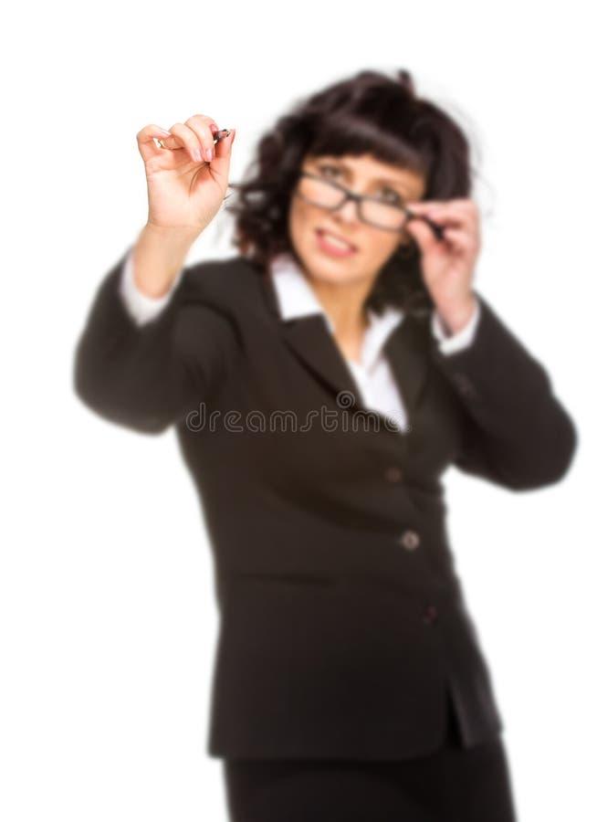 Vrolijke hogere bedrijfsvrouw met pen voor een virtuele wh stock foto's