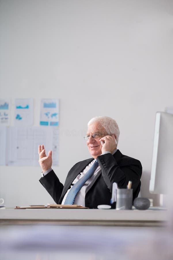 Vrolijke hogere werkgever royalty-vrije stock afbeelding