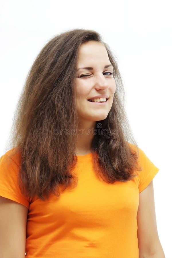 Vrolijke jonge vrouw die over witte achtergrond knipogen royalty-vrije stock afbeeldingen