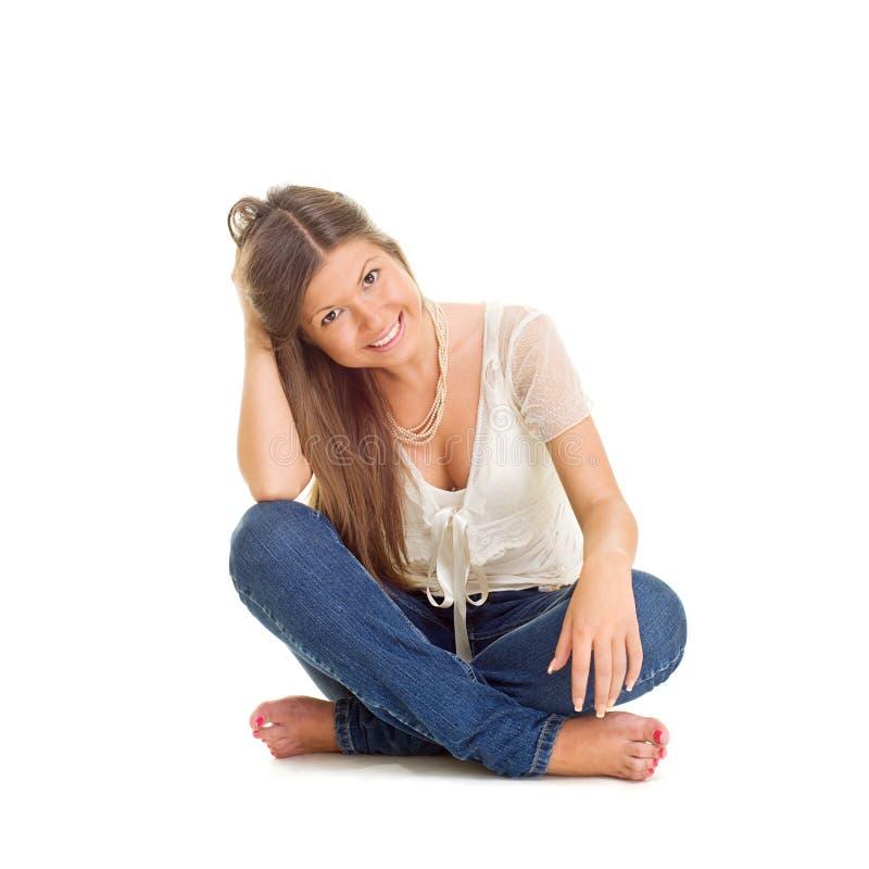 Vrolijke jonge vrouw in jeans stock afbeeldingen