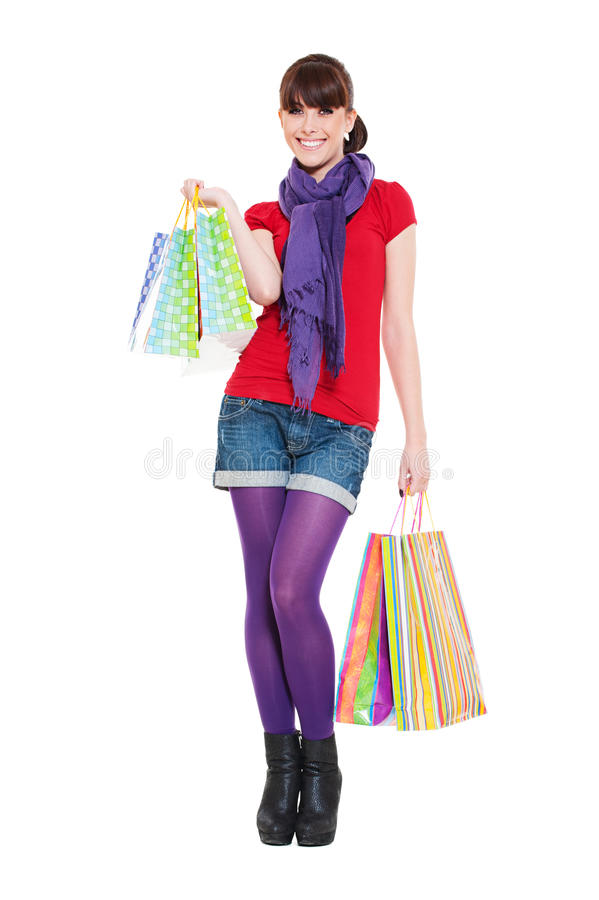 Vrolijke jonge vrouw met het winkelen zakken royalty-vrije stock afbeeldingen