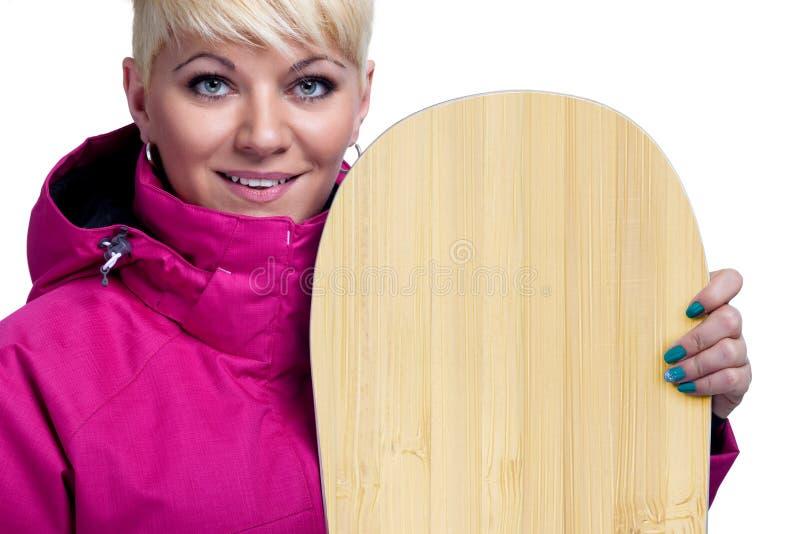 Vrolijke jonge vrouw met snowboard royalty-vrije stock afbeelding