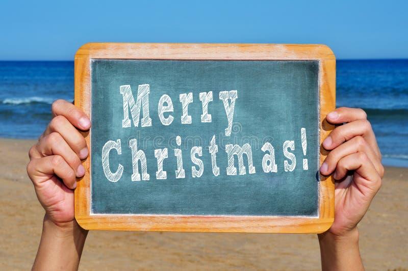 Vrolijke Kerstmis op het strand royalty-vrije stock afbeeldingen