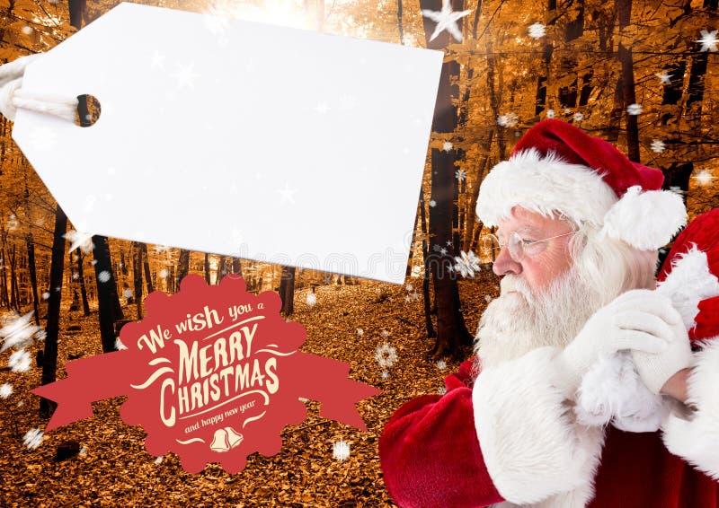 Vrolijke Kerstmisgroeten met de holdingszak van de Kerstman stock afbeeldingen