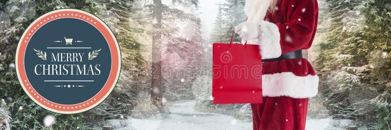 Vrolijke Kerstmistekst en Kerstman met het winkelen zak royalty-vrije stock foto's