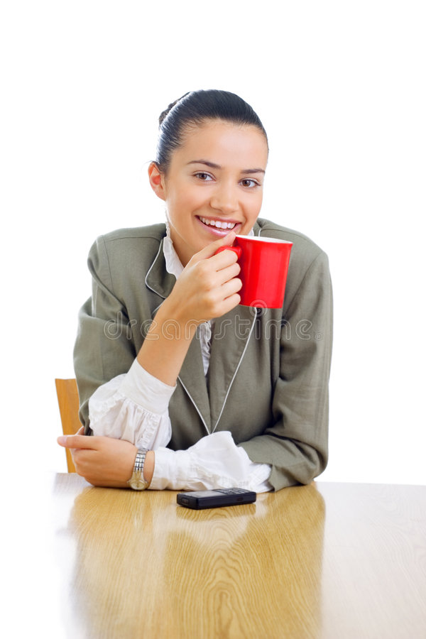 Vrolijke onderneemster het drinken koffie stock afbeelding