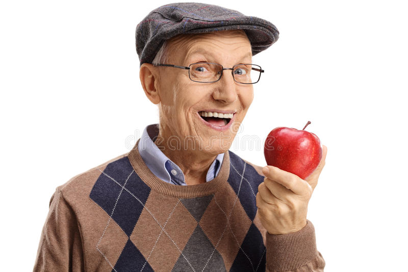 Vrolijke oudste die een appel hebben royalty-vrije stock afbeelding