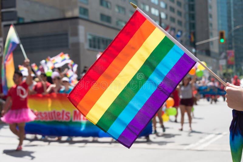 Vrolijke regenboogvlag bij vrolijke de trotsparade van Montreal royalty-vrije stock foto's