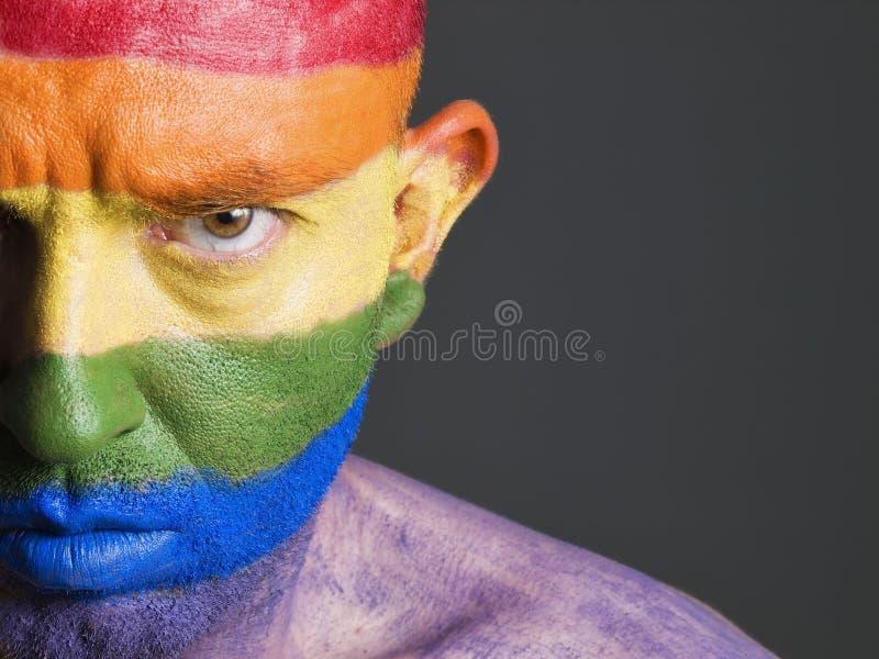 Vrolijke vlag geschilderde gezichtsmens, ernstige uitdrukking. royalty-vrije stock foto