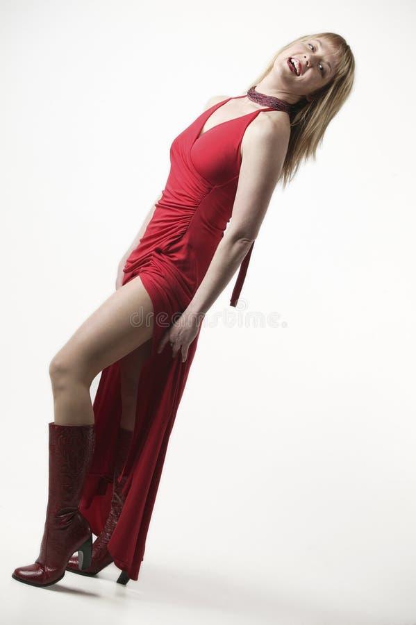 Vrolijke vrouw in rode kleding royalty-vrije stock foto's
