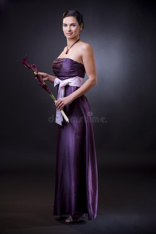 Vrouw in avondjurk stock fotografie