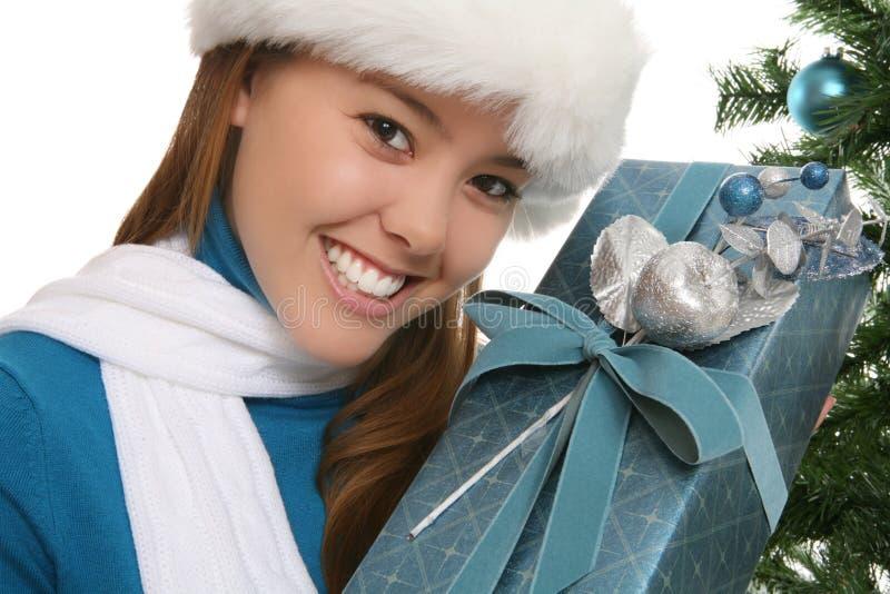 Vrouw bij Kerstmis stock foto's