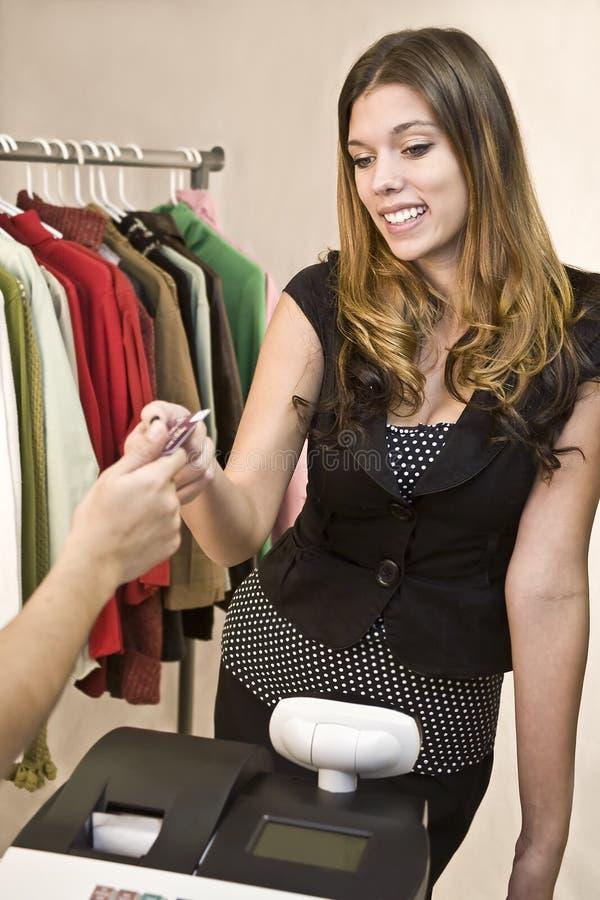 Vrouw bij register stock foto