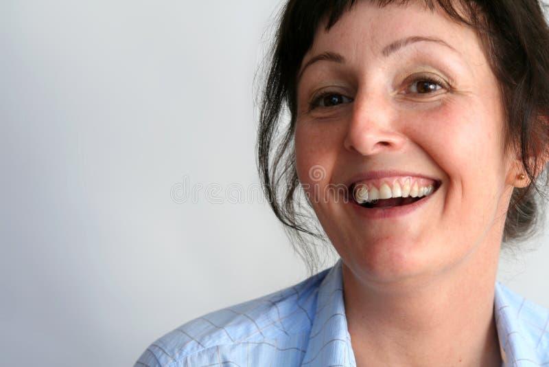 Vrouw in blauw overhemd royalty-vrije stock afbeelding