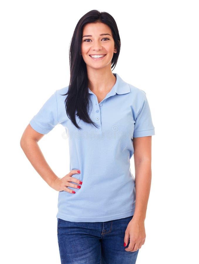 Vrouw in blauw polooverhemd op een wit stock foto