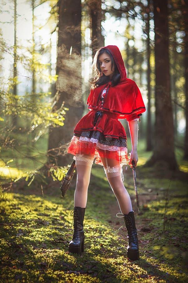 Vrouw in Carnaval kostuum Sexy Weinig het Rode Berijden stock afbeeldingen