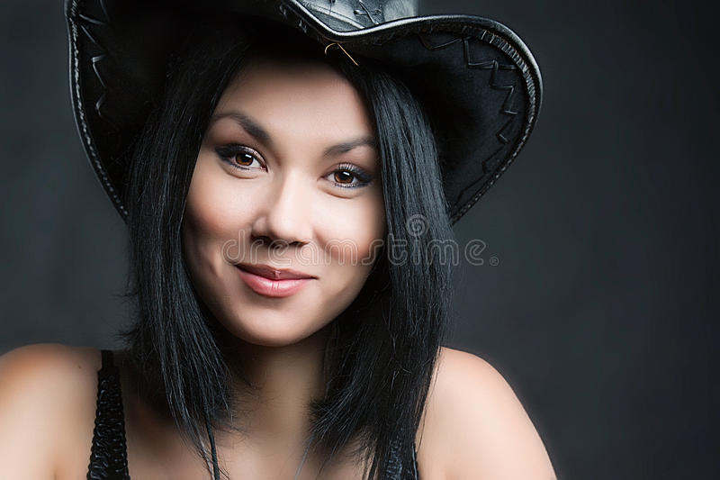 Vrouw in cowboyhoed stock fotografie