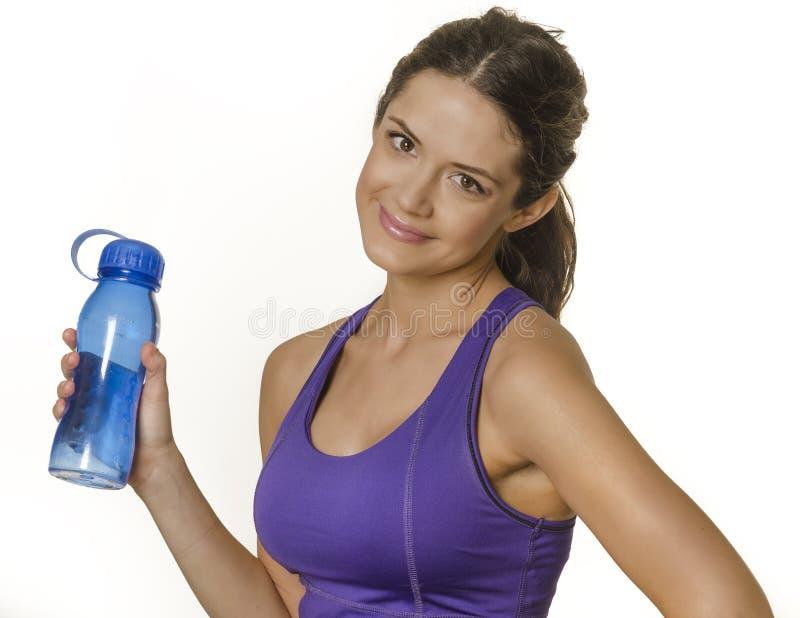 Download Vrouw In De Fles Van Het De Holdingswater Van De Sportkleding Stock Afbeelding - Afbeelding bestaande uit levensstijl, oefening: 29511811