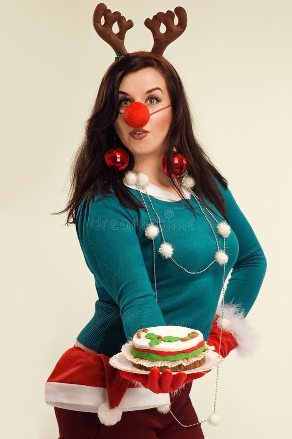 Vrouw in de geest van Kerstmis royalty-vrije stock afbeelding