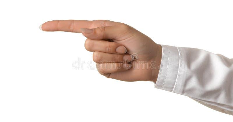 Vrouw de hand van de arts toont vinger aan de kant op wit geïsoleerde achtergrond De gebaren van de hand royalty-vrije stock foto's
