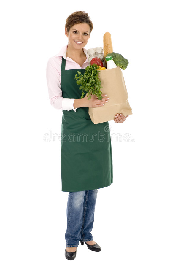 Vrouw in de kruidenierswinkelzak van de schortholding stock foto