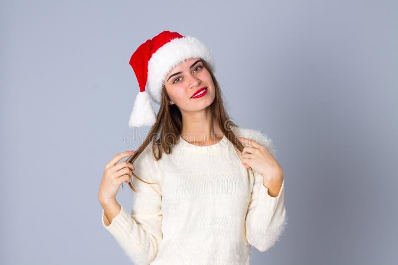 Vrouw in de rode hoed van Kerstmis royalty-vrije stock afbeelding