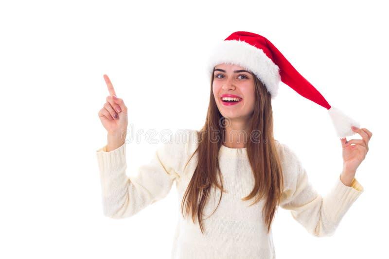 Vrouw in de rode hoed van Kerstmis stock foto