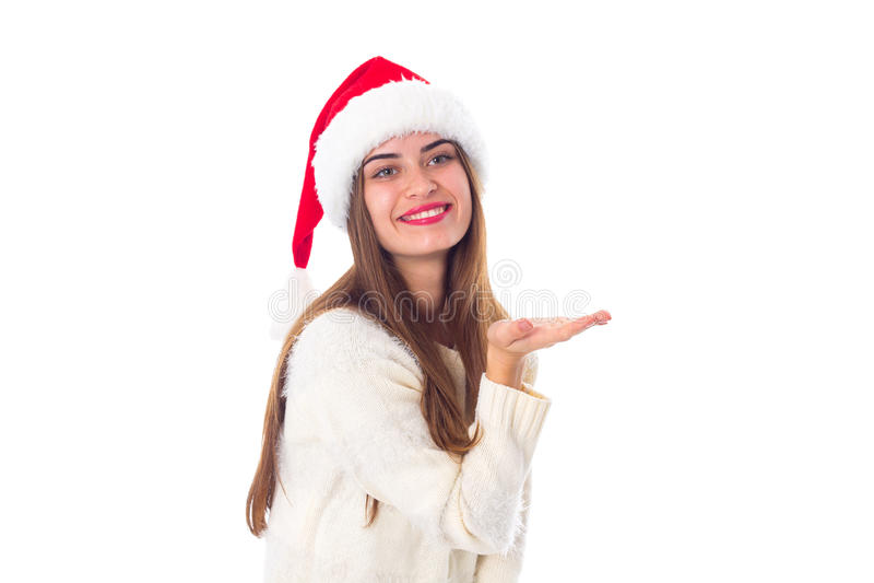 Vrouw in de rode holding van de Kerstmishoed iets royalty-vrije stock foto