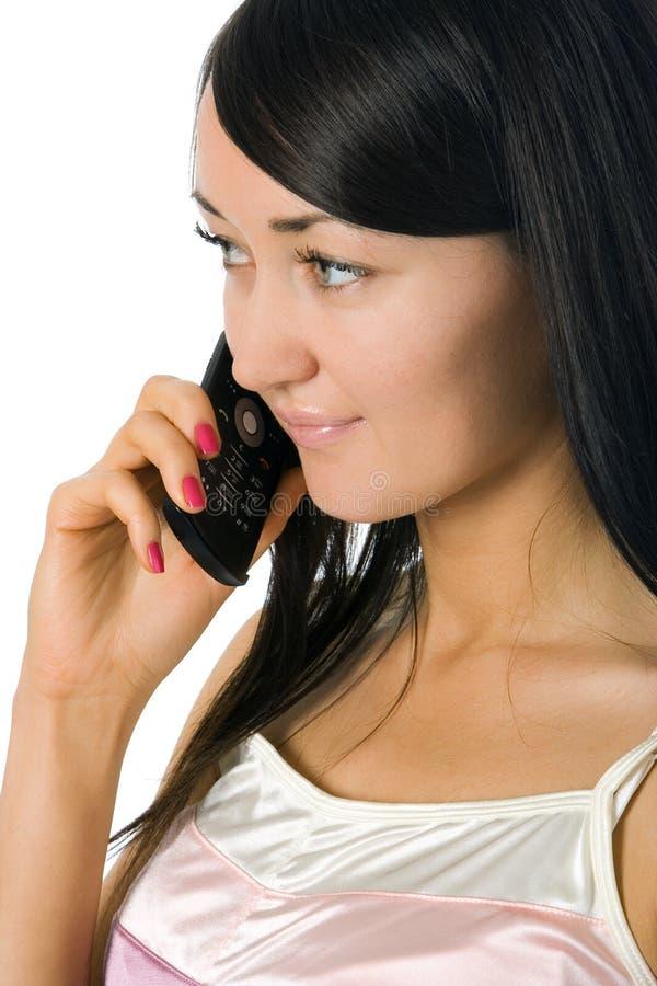 Vrouw die door celtelefoon roept royalty-vrije stock afbeelding