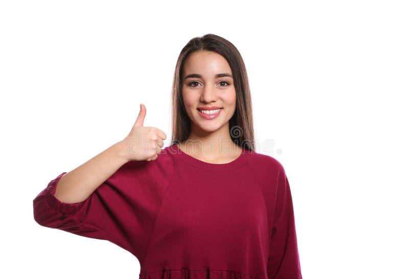 Vrouw die DUIM OP gebaar in gebarentaal op wit tonen royalty-vrije stock fotografie