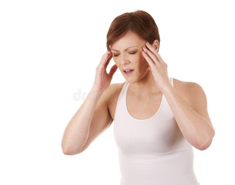 Vrouw die een hoofdpijn hebben stock fotografie