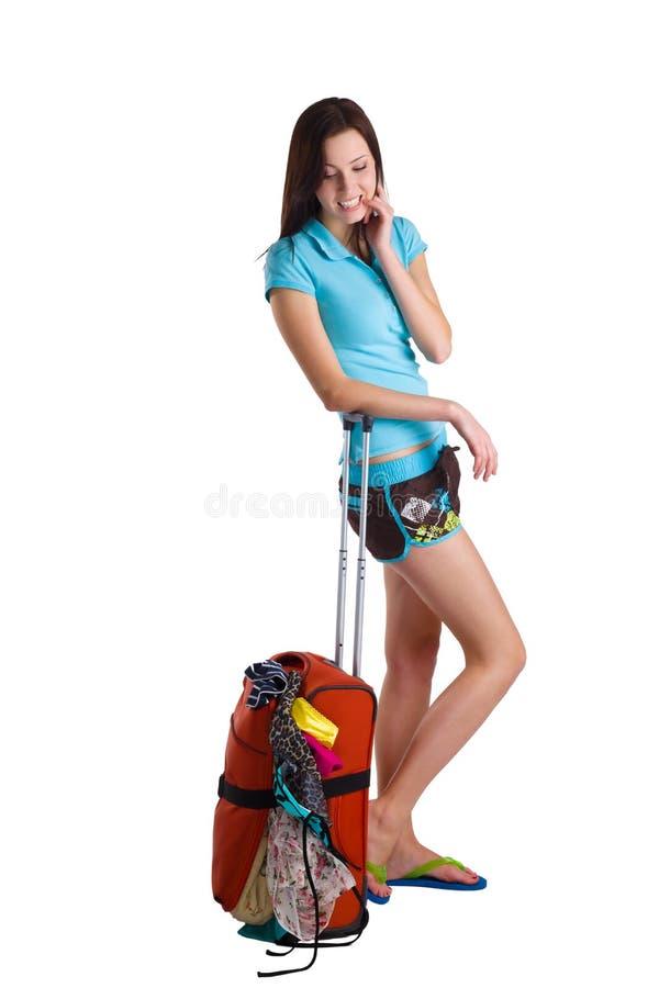 Vrouw die een koffer houdt stock afbeeldingen