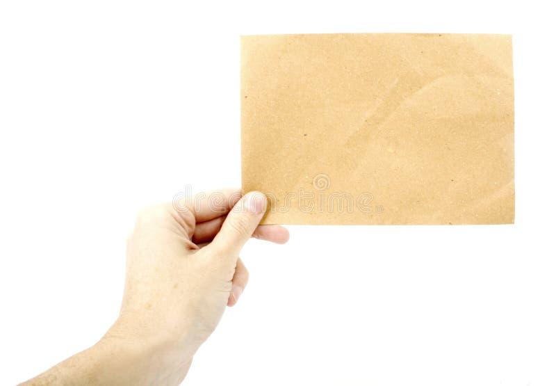 Vrouw die een stuk van gerecycleerd document houdt stock foto