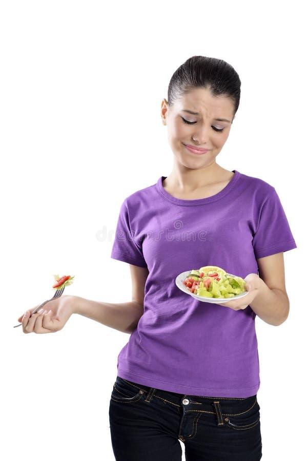 Vrouw die gezonde salade eten stock afbeelding