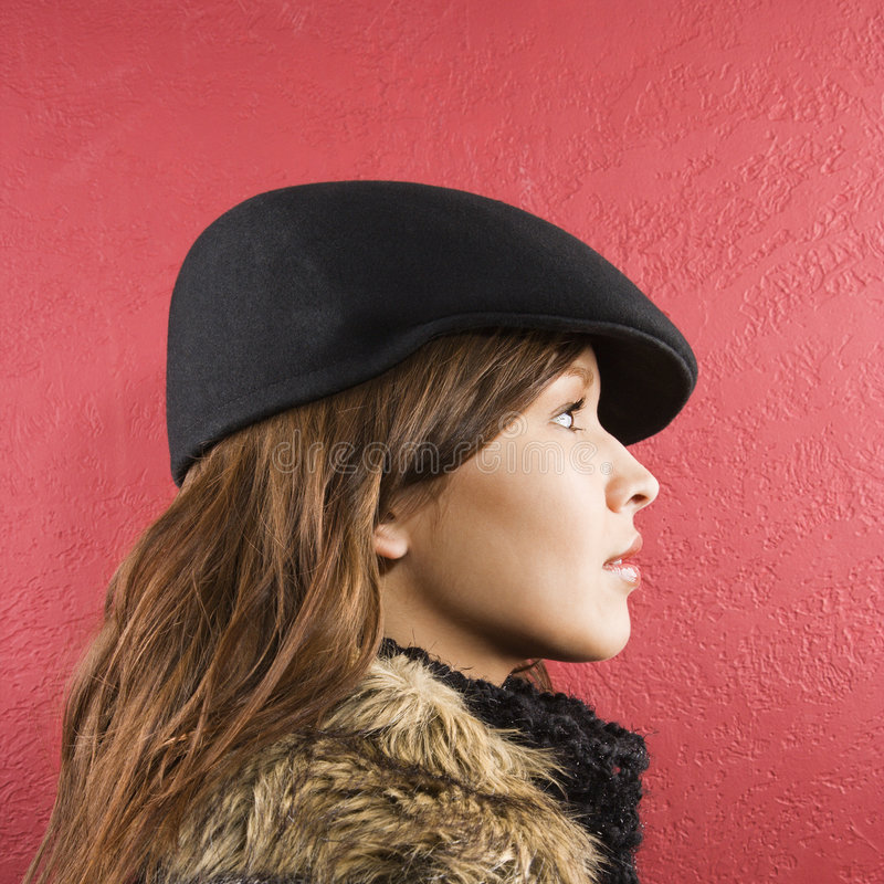 Vrouw die hoed draagt. royalty-vrije stock afbeeldingen