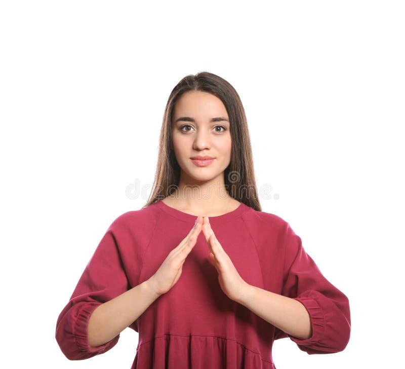 Vrouw die HUISgebaar in gebarentaal op wit tonen stock fotografie