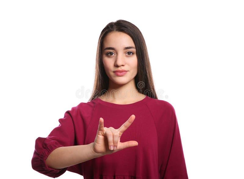 Vrouw die I-LIEFDE U tonen gebaar in gebarentaal op wit royalty-vrije stock afbeelding