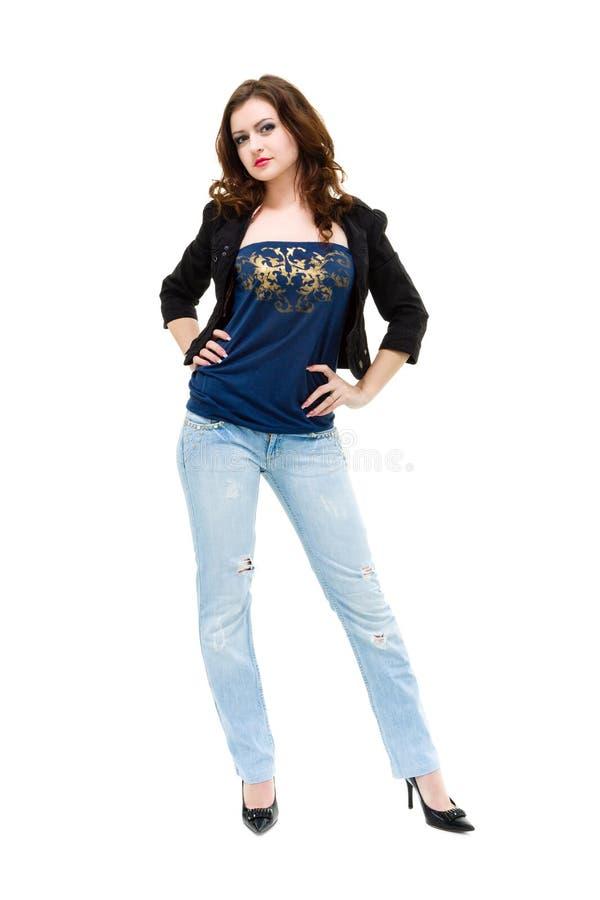 Vrouw die jeans het stellen dragen stock foto's