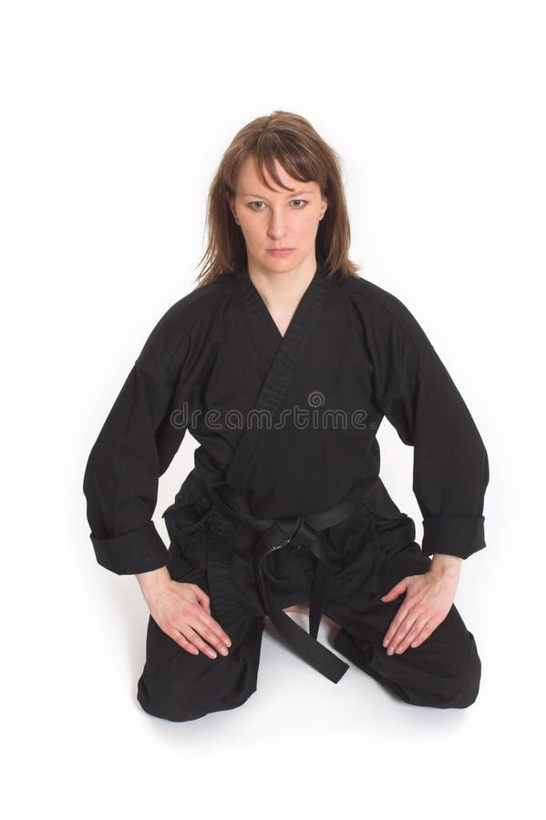 Vrouw die karate doet royalty-vrije stock afbeelding