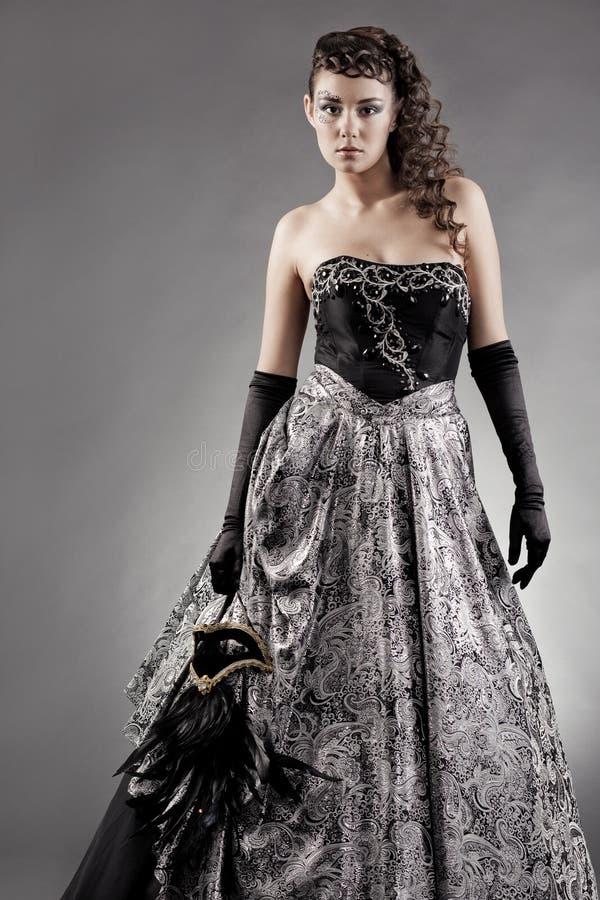 Vrouw die maskeradekostuum draagt royalty-vrije stock afbeeldingen
