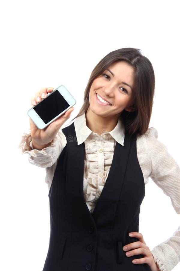 Vrouw die mobiele celtelefoon toont royalty-vrije stock foto's