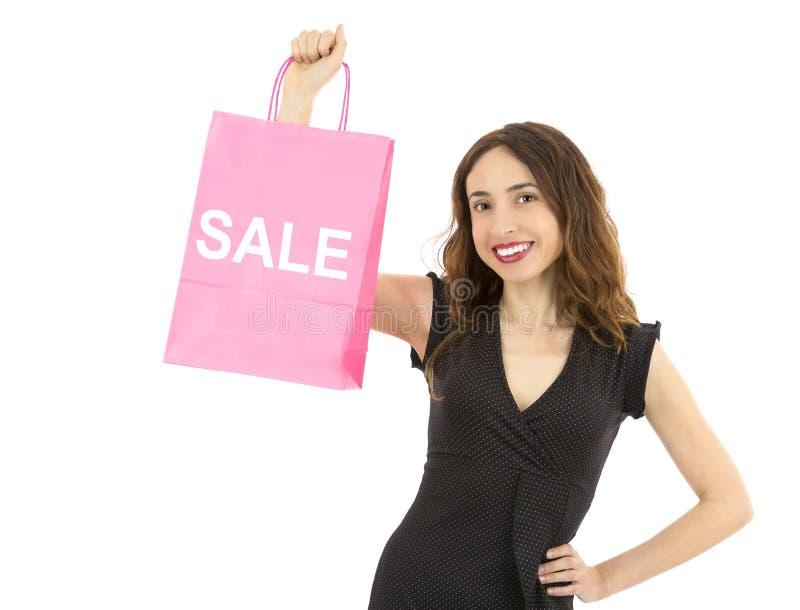 Vrouw die op document het winkelen het teken van de zakverkoop tonen stock afbeeldingen