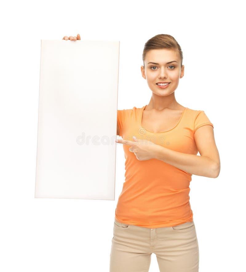 Vrouw die op witte lege raad richten royalty-vrije stock foto