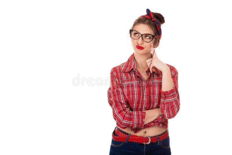 Vrouw die in peinzend en sceptisch het kijken denken stock afbeelding