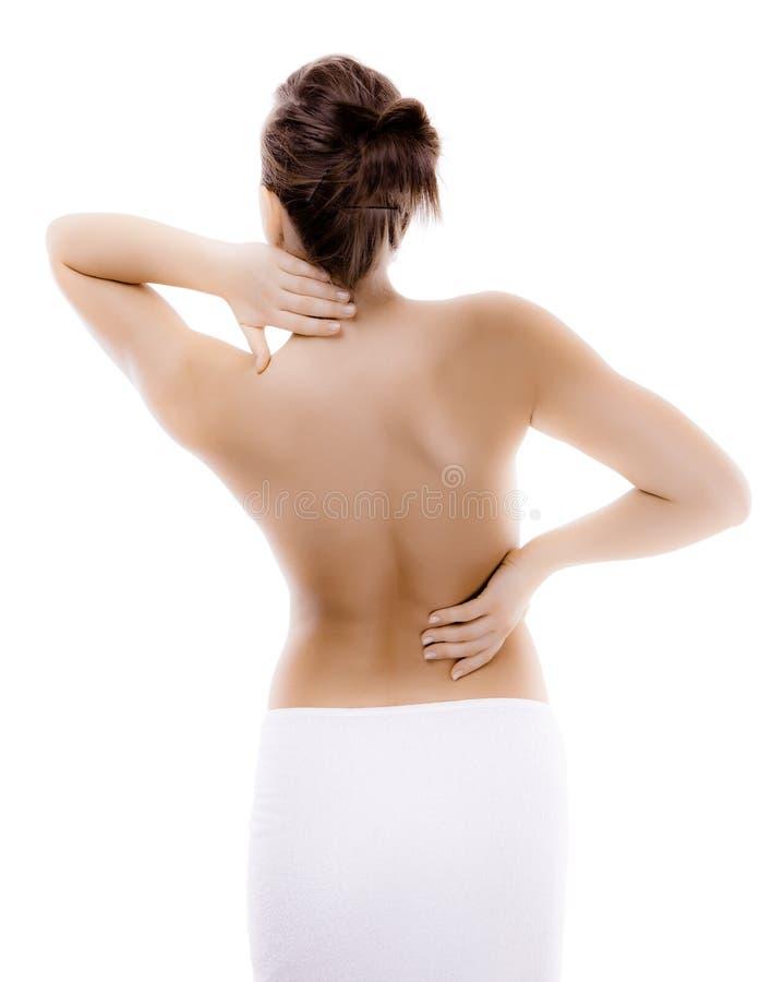 Vrouw die pijnrug masseert stock foto