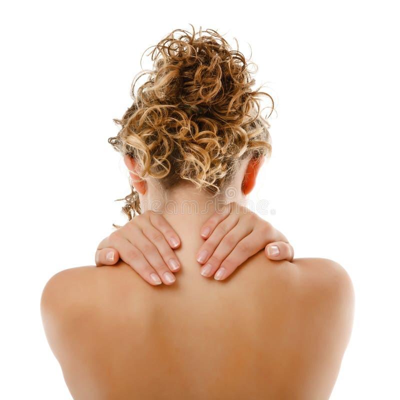 Vrouw die pijnrug masseert stock afbeeldingen