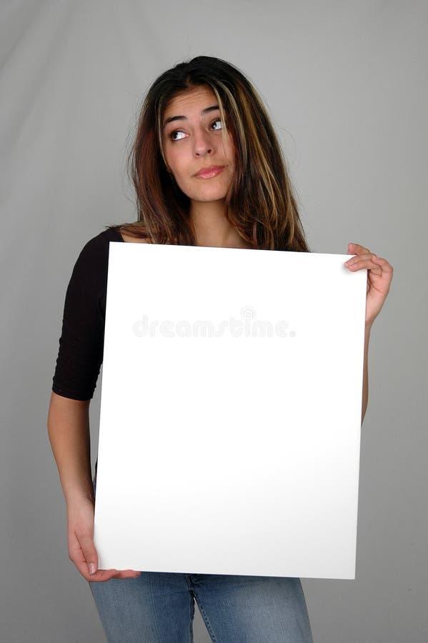 Vrouw die raad-7 houdt stock foto's