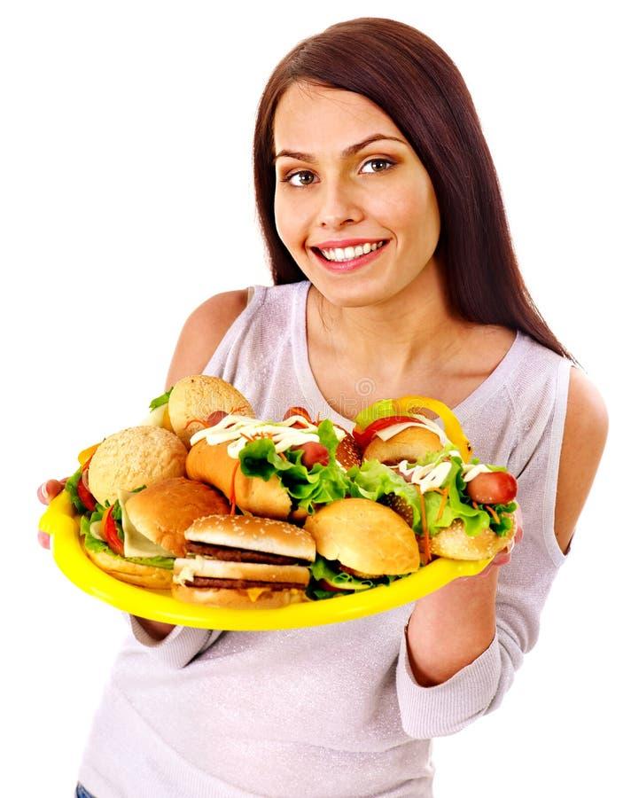 Vrouw die Snel Voedsel eet royalty-vrije stock afbeeldingen